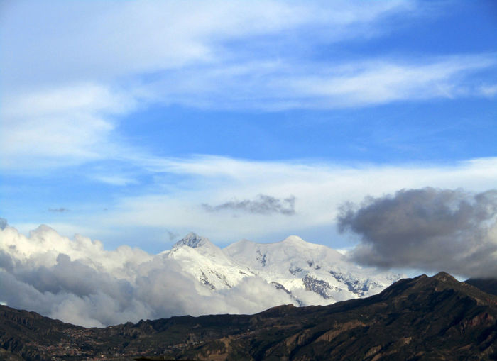 Illimani, La Paz, Bolivia. Illimani La Paz, Bolivia Mountain View Beauty In Nature Cloud - Sky Day Landscape Mountain Nature No People Outdoors Scenery Scenics Sky Snowcapped Wilderness