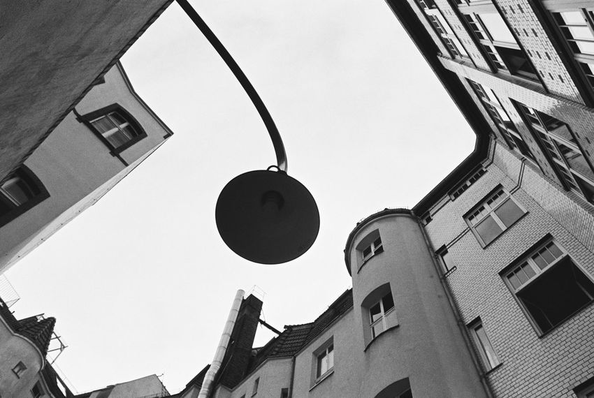 35mm Film Analogue Photography Film Nikon FA Black And White Monochrome Schwarzweiß Blackandwhite Photography Black & White Backlight Architecture Building Exterior Built Structure Clear Sky Day Hanging Lamp Low Angle View No People Outdoors Sky Streetlight Lookingup