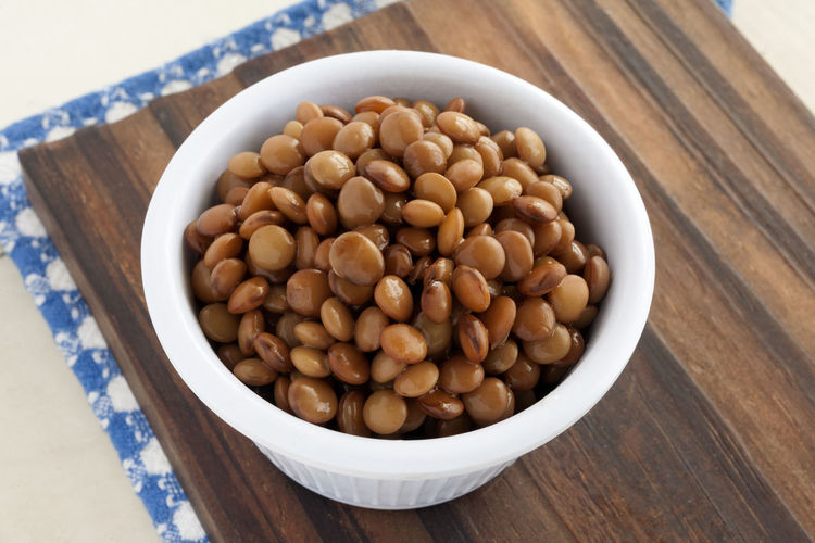 Boiled lentils bowl. Natural Light Blue Napkin Boiled Lentils Bowl Bowling Close-up Cooked Lentils Cutting Board Food Food And Drink Freshness Healthy Eating High Angle View Legume Legume Family Lentils No People Studio Photography Wood - Material Wooden Background