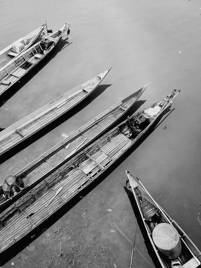 High angle view of boats moored at lakeshore