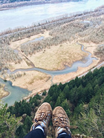Cropped image of person legs on cliff over columbia river gorge