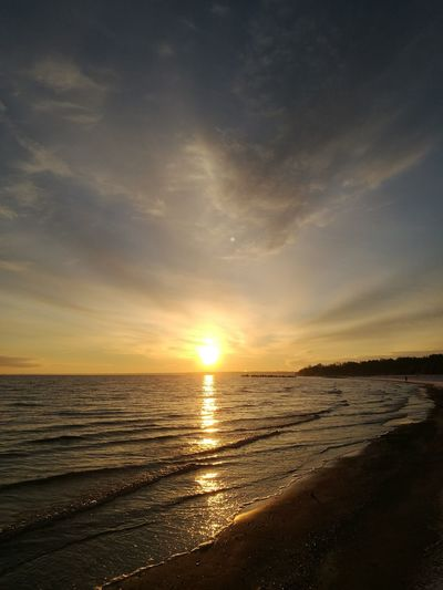 Sunset Sea Sun Beach Sky Reflection Beauty In Nature Outdoors Sand No People Horizon Over Water Nature Cloud - Sky Scenics Water Tranquility Vacations