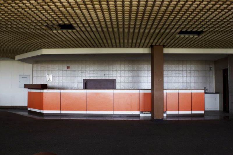 Empty subway with tiled wall
