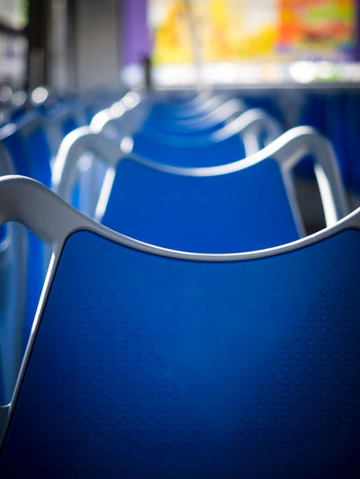 Close-up of empty blue seats in bus