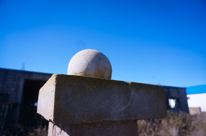 For the Love of Football⚽ Soccer Statue Made Of Stone Soccer Statue Blue Sky Built Structure Matter Soccer Ball Streetphotography Worldcup Clear Sky Old Technology Closeup Outdoors Minimal Minimalistic Minimalist Minimalart Statues And Monuments Sculpture Hand Made Statuesque