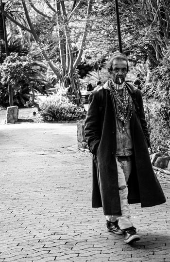 Street Photography Front View One Person Full Length Real People Tree Day Outdoors Standing Lifestyles Portrait Adult People Photography Cape Town Companys Garden Black And White Poverty Real Life Deprivation