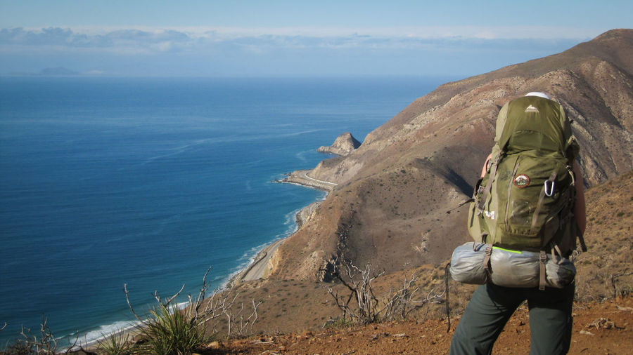Adult Adults Only Back Backpacking Beauty In Nature Blue California Day Hiking Malibu Nature Nature One Person Outdoors Overlighting People Real People Rear View Sea Sky Standing Water Wilderness