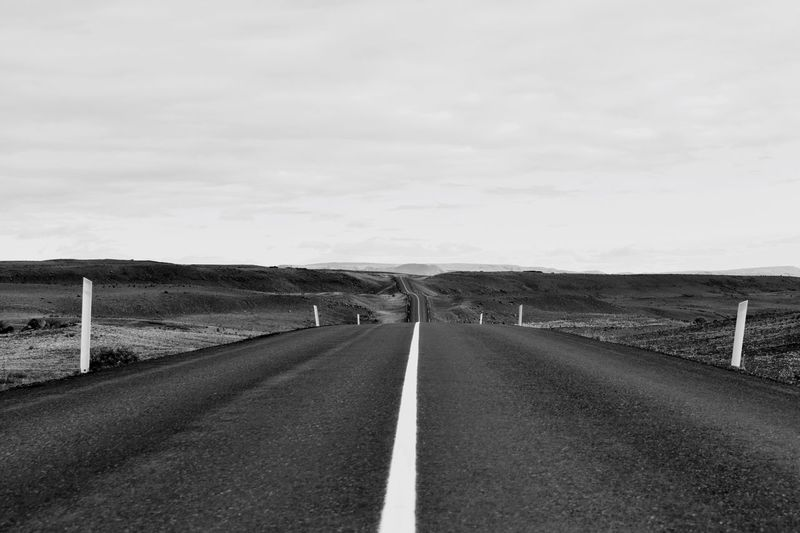 EyeEm Best Shots blackandwhite betterlandscapes Iceland sky Road symbol Sign direction the way forward Transportation road marking marking cloud - sky diminishing perspective environment tranquil scene landscape Nature no people day Tranquility Land Road vanishing point Hringvegur Iceland_collection EyeEm Best Shots Blackandwhite Betterlandscapes Iceland Sky Road Symbol Sign Direction The Way Forward Transportation Road Marking Marking Cloud - Sky Diminishing Perspective Environment Tranquil Scene Landscape Nature No People Day Tranquility Land Road Empty Road Road