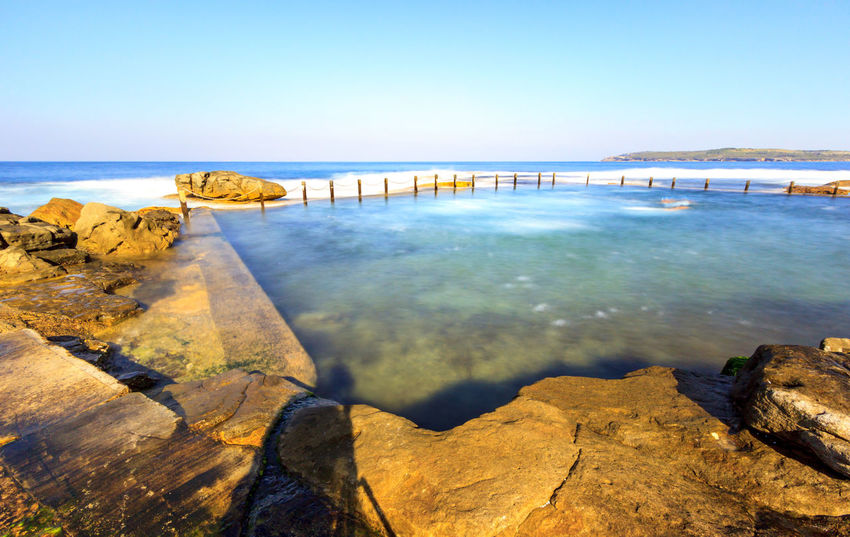 Slow down capture of the Mahon Rock Pool, with smooth waves and water Swimming Beach Beauty In Nature Blue Clear Sky Day Horizon Over Water Mahon Pool Nature No People Outdoors Pool Rock - Object Rock Pools Scenics Sea Sky Swimming Pool Tranquil Scene Tranquility Travel Destinations Water