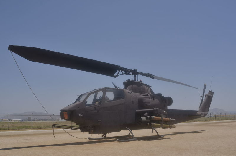 AH-1S Army Attack Aviation Blue Cobra Day Deterioration Helicopter Landscape Military Missle Nature No People Outdoors Renewable Energy Run-down Sky USMC Vietnam Warbirds Windmill