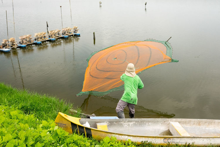 Adult Agriculture Casting A Net Day Farm Full Length Nautical Vessel Occupation One Person Outdoors People Real People Rural Scene Transportation Water