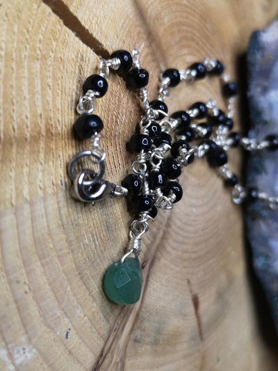 Close-up of chain hanging on wood