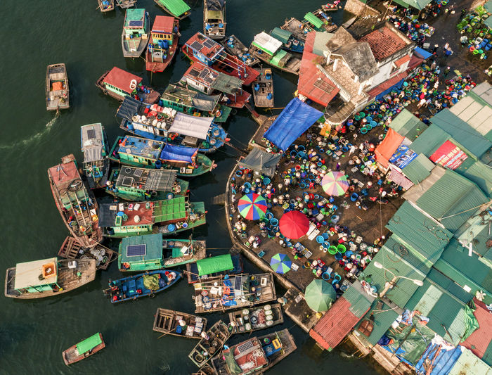High angle view of fishing boats and market