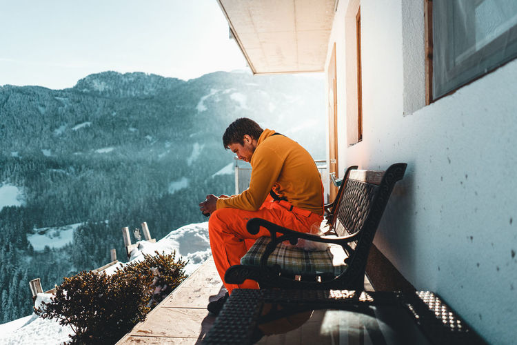 Real People Sitting Men One Person Architecture Young Men Sunlight Day Nature Leisure Activity Young Adult Lifestyles Mountain Adult Built Structure Casual Clothing Full Length Males  Outdoors