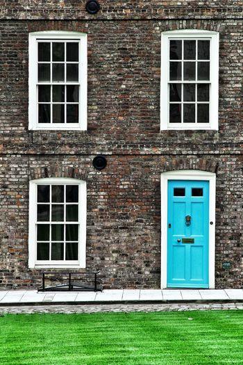 Front door of house with windows