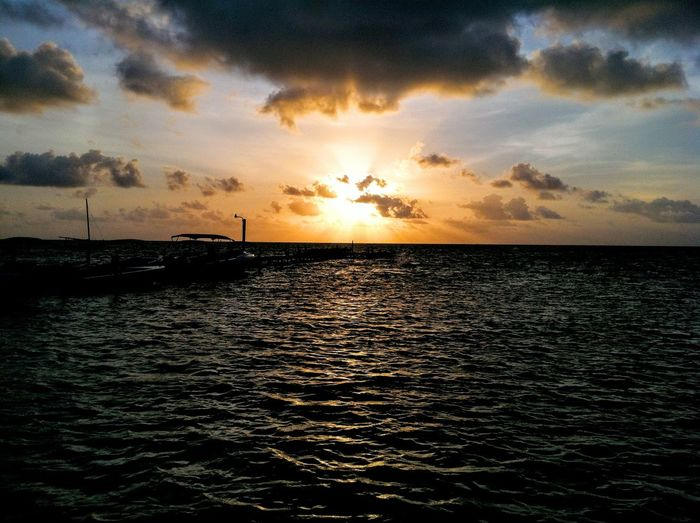 Amazing Sunrise #belize #caribbeansea #Sunrise #sunset #sun #clouds #skylovers #sky #nature #beautifulinnature #naturalbeauty #photography #landscape Beauty In Nature Cloud - Sky Horizon Over Water Idyllic Majestic Nautical Vessel Ocean Rippled Seascape Sun Tranquil Scene Waterfront