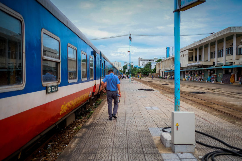 On board of the Reunification Express. Vietnam Architecture Cloud - Sky Day Full Length Men Mode Of Transportation One Person Outdoors Public Transportation Rail Transportation Railroad Station Railroad Station Platform Railroad Track Real People Sky Track Train Train - Vehicle Transportation Travel