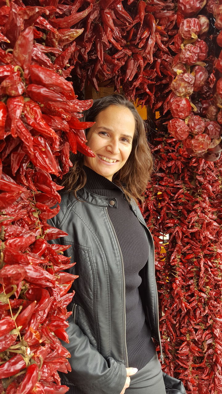 Portrait Of Mid Adult Woman Standing By Paprika At Market Stall