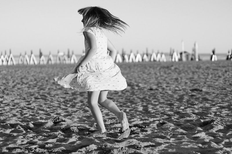 dancing on the beach Taking Photos Enjoying Life Fine Art Photography Schwarzweiß Beach Italy Travel Enjoying Life Expression Blackandwhite Blackandwhite Photography Mood Seaside Travel Destinations Person Child Eyeemphoto