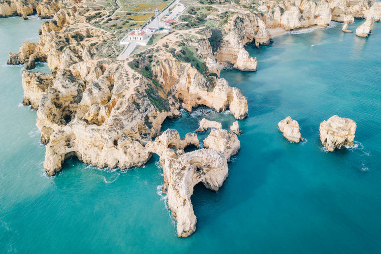 Algarve Atlantic Atlantic Ocean Coastline Drone  Lagos Ponta Da Piedade Tourist Attraction  Aerial View Algarve, Portugal Beach Beauty In Nature Blue Water Coast Day Dji High Angle View Nature No People Outdoors Rock - Object Scenics Sea Seaside Tourist Resort Tranquil Scene Tranquility Travel Destinations Water Waterfront