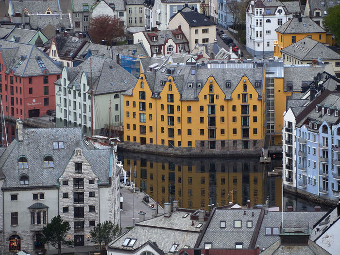 View from above on town Ålesund, Norway Building Exterior Built Structure Architecture Building City Residential District High Angle View Day No People House Town Cityscape Outdoors Roof Travel Destinations Yellow Motor Vehicle Car Row House Settlement TOWNSCAPE