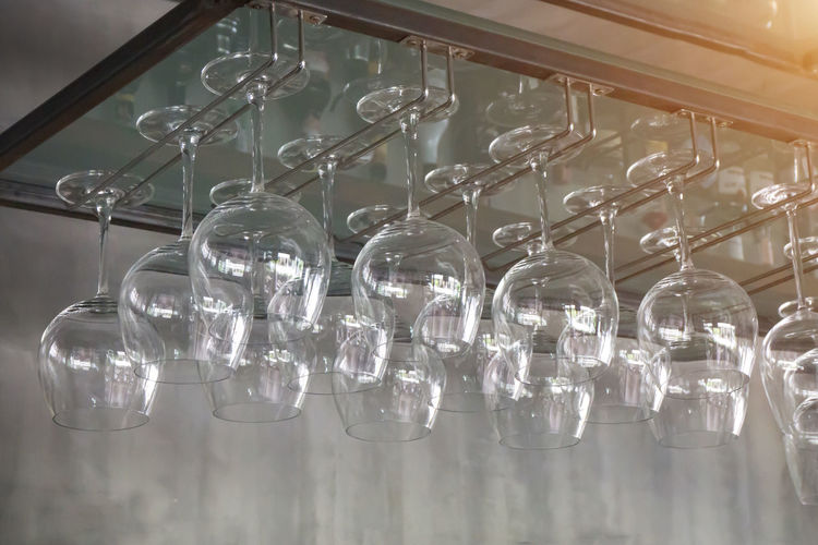 Wine Glass Ceiling Close-up Electric Light Electricity  Focus On Foreground Glass Glass - Material Group Group Of Objects Hanging In A Row Indoors  Large Group Of Objects Light Light Bulb Lighting Equipment Luxury No People Rack Still Life Technology Transparent Wine Wineglass