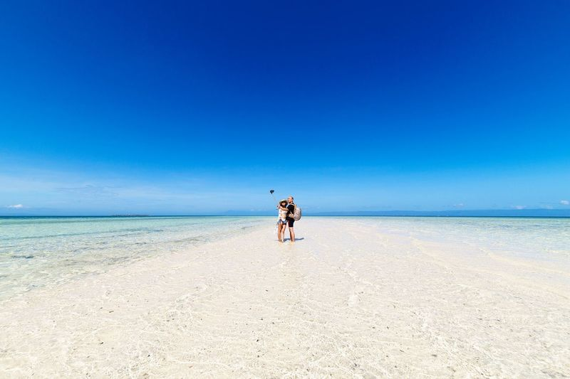 EyeEm Selects Beach Sand Sea Full Length Horizon Over Water Blue Sky Clear Sky Outdoors Adult Day Young Adult Summer Scenics People Standing virgin island, bohol, philippines, summer, panglao Philippines
