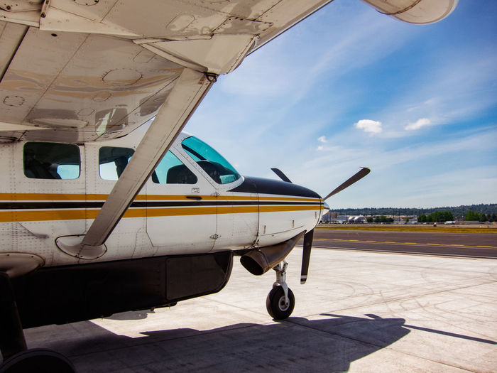 the plane to Mount Rainier. Air Vehicle Airplane Blue Cessna Clear Sky Copy Space Flying Fun Journey Low Angle View Mode Of Transport On The Move Propeller Recreational Pursuit Sparse Clouds Transportation Travel Under Wing Feel The Journey