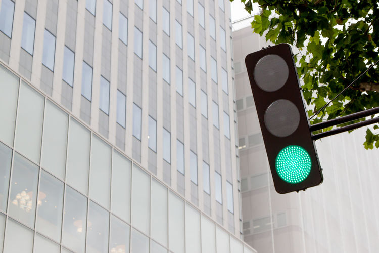 """Go"". Taken in Sapporo, Japan. Architecture Building Building Exterior Built Structure Car Check This Out City City City Life City Street Cityscapes Deceptively Simple Enjoying Life Eye4photography  Go Green Guidance Hello World Hokkaido Information Japan Land Vehicle Modern Office Building On The Road Positive Quiet Sign Simple Skyscraper Street Street Light Streetphotography Symbol Taking Photos Traffic Traffic Lights Travel Traveling"