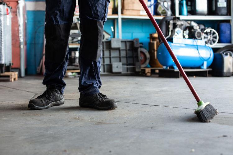 Low section of men working on floor