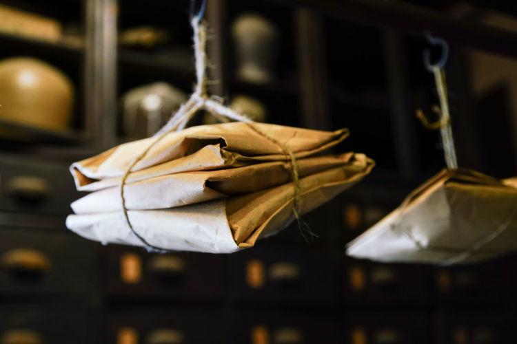 Close-up of envelopes hanging in darkroom