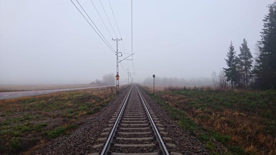 Railroad Tracks Against Foggy Weather