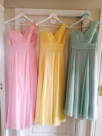 Pastel Power Bridesmaid Dress Spring Wedding Pastel Colors Pastel Dresses Wedding Bridesmaids Pink Lemon Turquoise In A Row Choice Multi Colored Variation Retail  Still Life Dress Indoors  Fashion Clothing Coathanger No People Group Of Objects Womenswear Order Textile Side By Side Hanging Pink Color