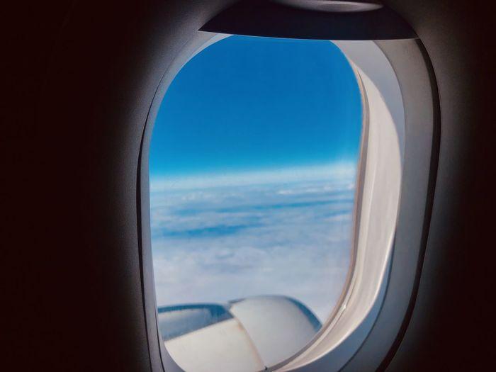 View of sea through airplane window