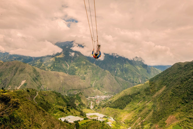 Adventure Beauty In Nature Cloud - Sky Day Extreme Extreme Sports Hanging Landscape Man Mountain Mountain Range Nature One Person Outdoors Overhead Cable Car Paragliding People Real People Scenics Sky South America Swing Tranquil Scene Tranquility Tree