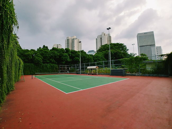Architecture Building Exterior Built Structure City Cloud - Sky Court Day Modern No People Outdoors Playing Field Sky Skyscraper Sport Tennis Tree