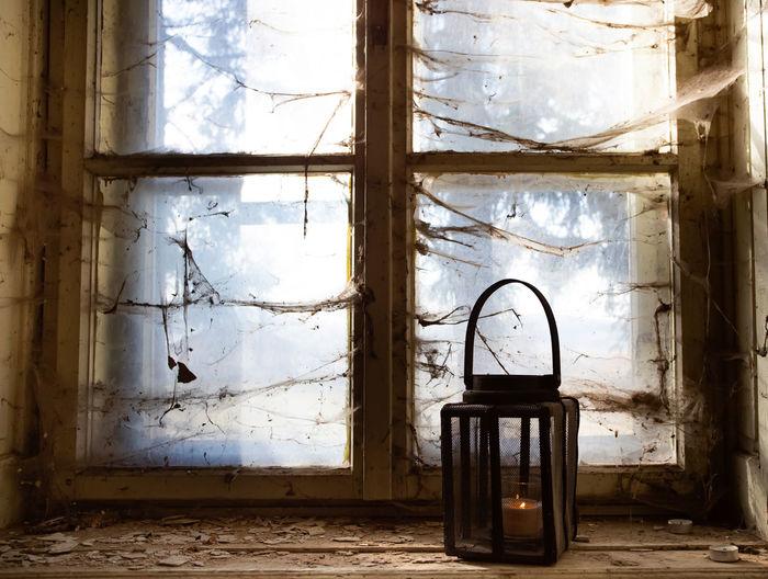 Abandoned building seen through window