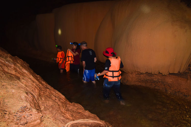 ถ้ำน้ำวังศรีธรรมโศกราช Tham nam wang cave - Nakhon si thammarat - Thailand HEAD Thai Cave Cave In Thailand Child Flashlight Flooding Full Length Group Group Of People Illuminated Life Jacket Lifestyles Men Nature People Real People Rear View Rock Rock Formation Row Stalactites And Stalagmites Standing Togetherness Walking Women