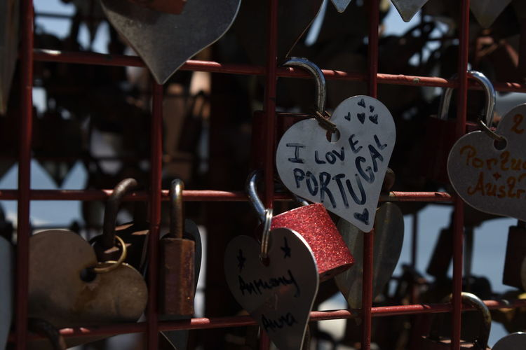 Close-up of padlocks hanging on heart shape