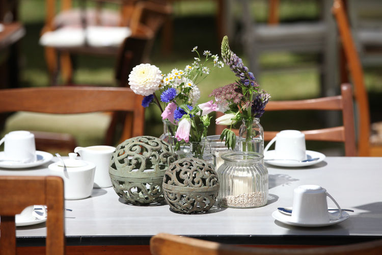 Close-up of flower vases on dining table at restaurant