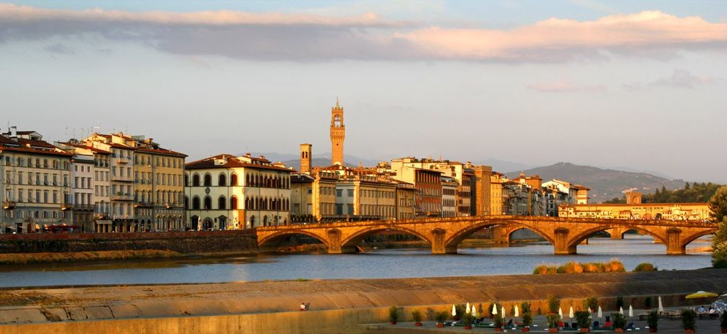 Late afternoon sunshine across the River Arno Florence Italy towards the Ponte alla Carraia with the Ponte S. Trinita and Ponte Vecchio behind Ponte Alla Carraia River Arno Travel Photography Architecture Bridge - Man Made Structure Building Exterior Built Structure City Cityscape Cloud - Sky Connection Day Mountain Nature No People Outdoors River Scenics Sky Sunset Tourist Destination Travel Destinations Urban Skyline Water Waterfront