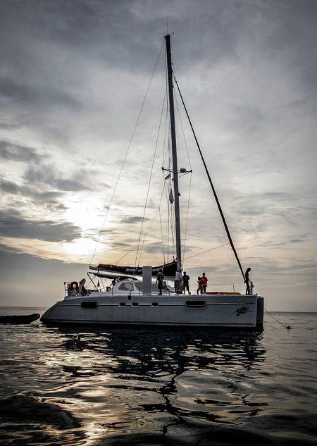 catamaran in Tioman Island, Pahang, Malaysia Catamaran Cruise Catamaranboat Clouds And Sky Day Islands Pulleys,sheaves & Bars Ropes Sailing Boat Sea Yatch Marine Yatchs