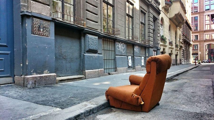 Empty armchair in the street