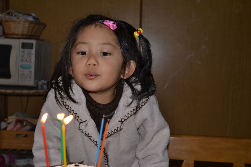 Candle One Girl Only One Person Celebration Flame Child Birthday Cake Childhood Portrait Girls Looking At Camera Children Only Happiness Front View Birthday Candles People Birthday Burning Headshot Indoors