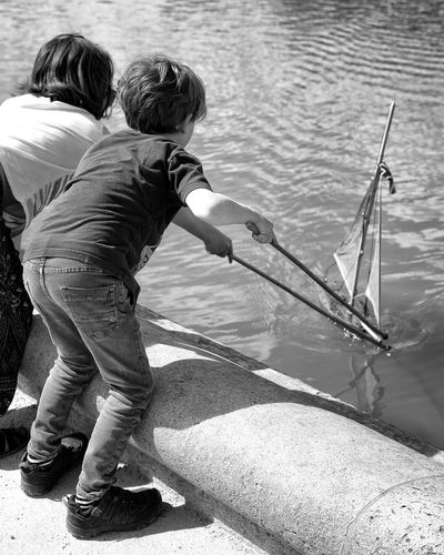 Boats in the pond The Street Photographer - 2017 EyeEm Awards Water Two People Real People Child River Outdoors Childhood Nautical Vessel Day Standing People Children Only Paris, France  Jardin Du Luxembourg