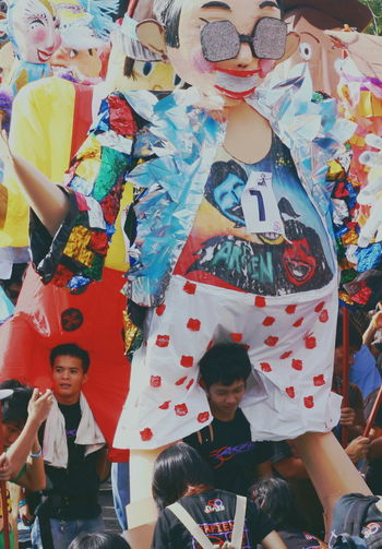 Carry On Shoulders Colorful Festival Giant Puppets Large Group Of People Masks Masskara Festival Multi Colored Odd Job Puppets Standing The Portraitist - 2017 EyeEm Awards The Street Photographer - 2017 EyeEm Awards Togetherness