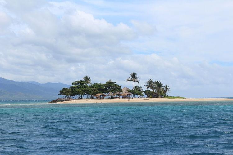 Travel Photography Summertime Island Hopping Beach Photography Blue Wave Blue Sea Sunnyday☀️ More Fun In The Philippines  Dos Palmas Palawan Beach
