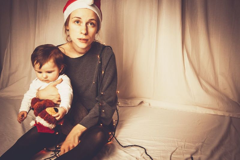 tired mother christmas burnout Christmas Hat Light Strings Christmas Christmastime Mother Sad Face Frustration Tired Burnout EyeEm Selects Childhood Child Family Adult Parent Females Indoors  Baby Portrait Emotion Family With One Child