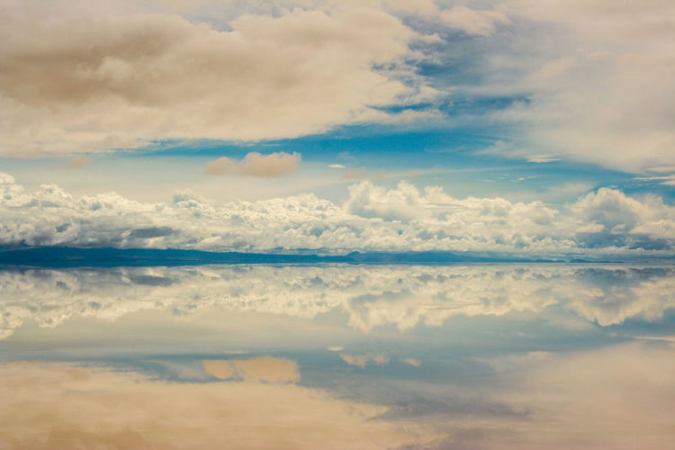 Salar De Uyuni Aerial View Beauty In Nature Calm Cloud Cloud - Sky Cloudscape Cloudy Day Majestic Mountain Nature No People Non-urban Scene Ocean Outdoors Reflection Remote Scenics Sea Sky Standing Water Tranquil Scene Tranquility Water Waterfront