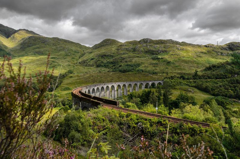 Scenic view of bridge over landscape against sky